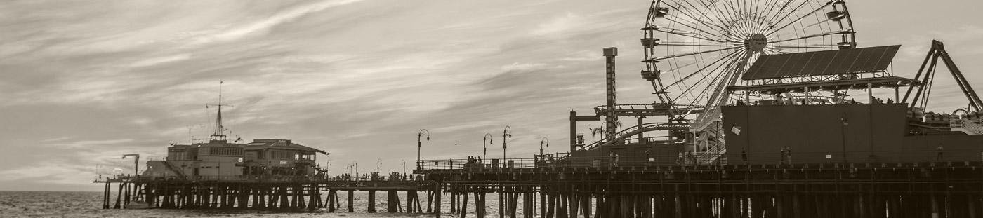 Black and white photo of the Santa Monica Pier.